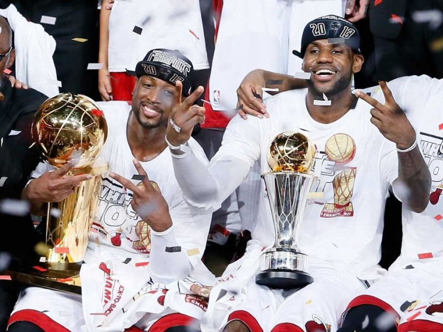 Miami Heat superstars LeBron James and Dwyane Wade celebrate after winning the NBA Championship last season (photo by Kevin C. Cox/Getty Images).