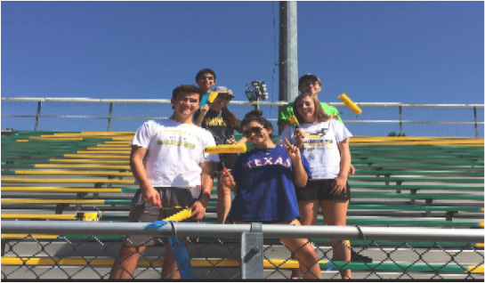Kaitlin Bonacci and other school leaders on the bleachers. They help out our school every day.