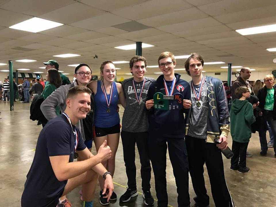 Langley rowers pose after collecting their medals after the big win against West Springfield