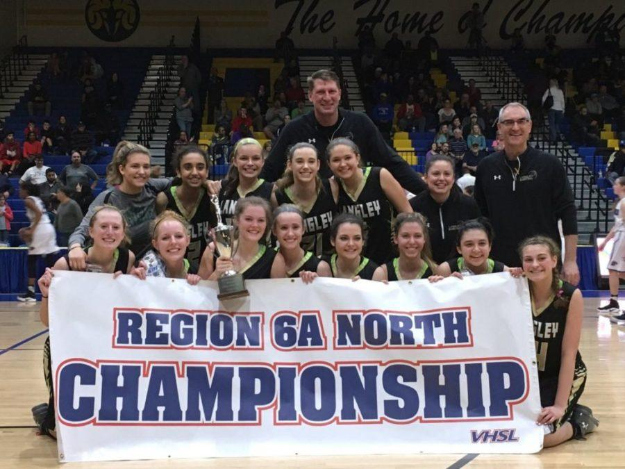 Pictured+is+the+girls+basketball+team+with+the+coaches+on+the+right+holding+the+regional+championship+banner.+They+will+play+the+first+round+of+the+state+championship+on+March+3rd