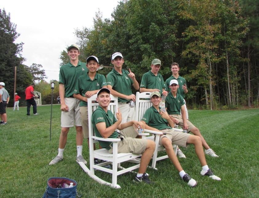 The Saxon golf team relaxes following their win