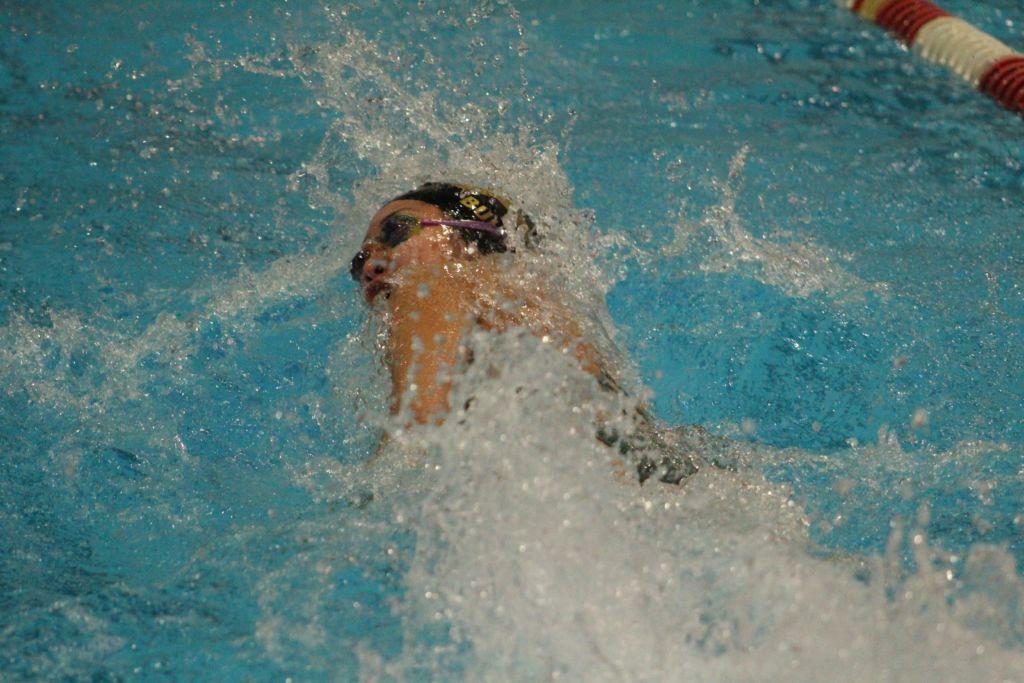 Senior and Girls' Swim Captain, Julia Bullock, making strides in 100 freestyle.
