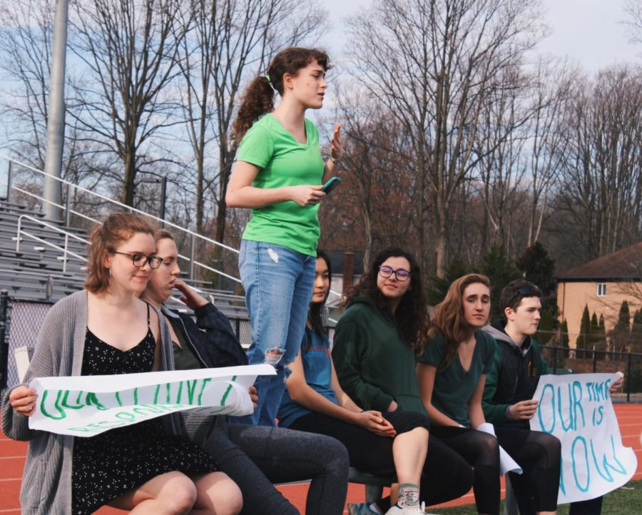The organizers of the Climate Strike (from left to right: Lindsay Nyquist, Lizzy Gersony, Reece Herbery, Katherine Sano,Eliza Siegel, Anna Spear, and Connor Graves) gathered up in front of the crowd of strikers making call-to-action speeches.