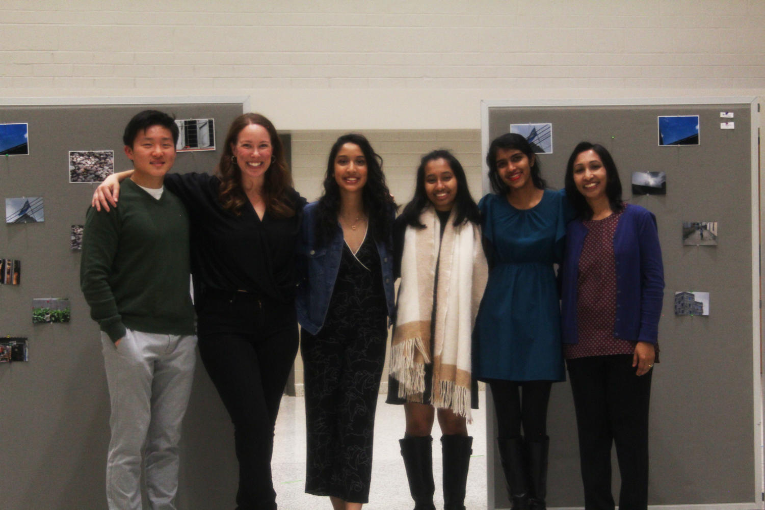 Leaders of the 100 Cameras Snapshot Dhaka Project gathered at their gallery opening at Langley. Left to right: Andrew Kim (Thomas Jefferson Senior), Amanda Archibald (Langley Photo Teacher), Sumaiya Haque (Langley Senior), Mehran Sajjad (Thomas Jefferson Senior), and Ananya Amirthalingam (Langley Senior).
