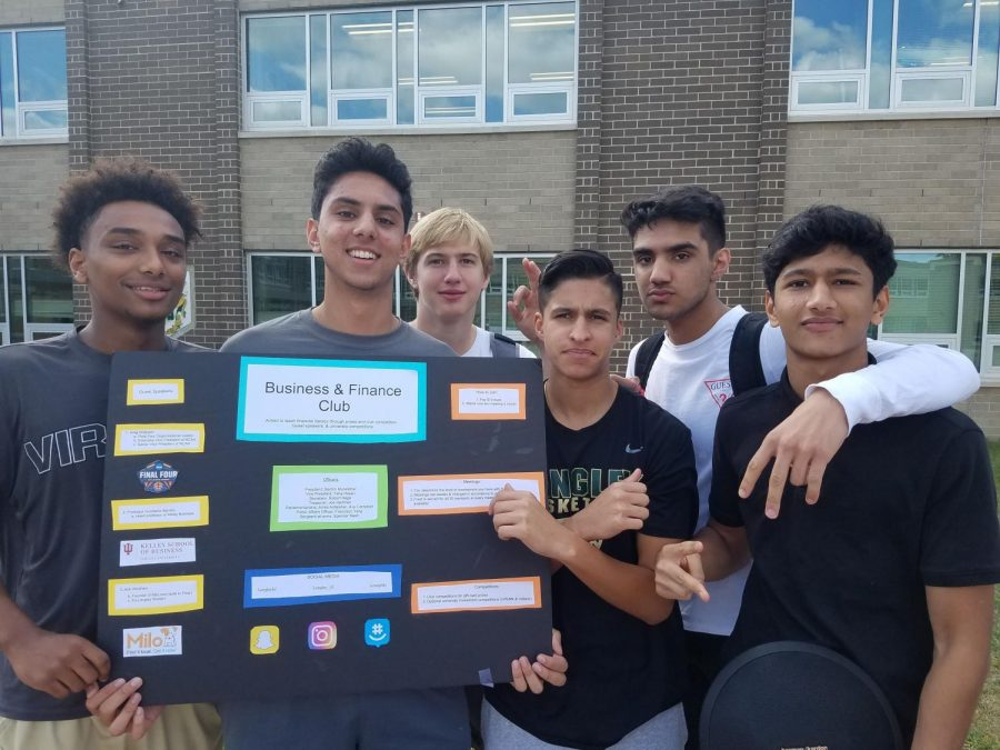 Members of the Finance Club display their tri-fold board at Club Day (Photo by David Song).