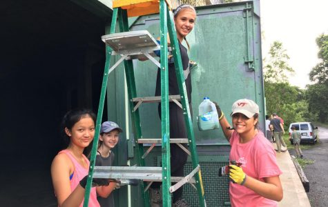 Ana El-Bogdadi stands painting a door alongside fellow volunteers in Puerto Rico. El-Bogdadi has valued community service, especially its intersections with spirituality, from a young age (Photo by El-Bogadi).