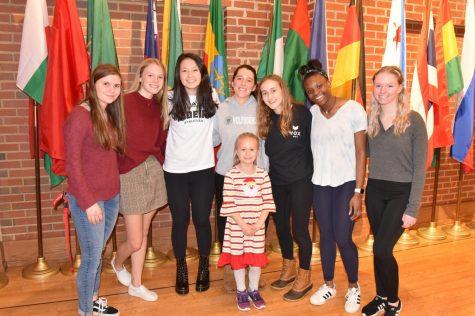 From left to right: Caroline Cassidy, Alison Buckler, Rachel Rhee-Feitel, Olivia Carnot, Katherine Moe, Laila White, and Reese Villella pose with 6-year-old Sydney Belsher, a recovered cancer patient whose story inspired the girls to take action in conjunction with the Belsher family (Photo by Belsher).