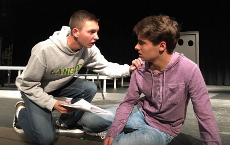 Senior Peter Fox and junior Cole Sitilides perform lines during the winter production of Romeo and Juliet. The political twist on an old Shakespearean classic produced commentary on the current climate of policy many Saxons related to (Photo by Shakeel).