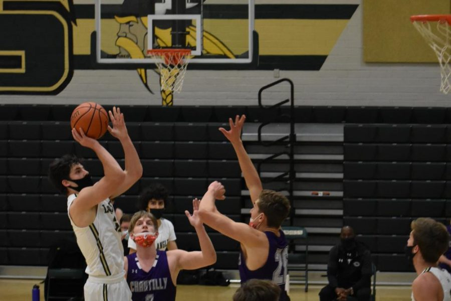 Senior Michael Hoeymans (#33) shoots and scores during the second quarter. Hoeymans finished off the game as Langleys second-highest scorer with 15 points.