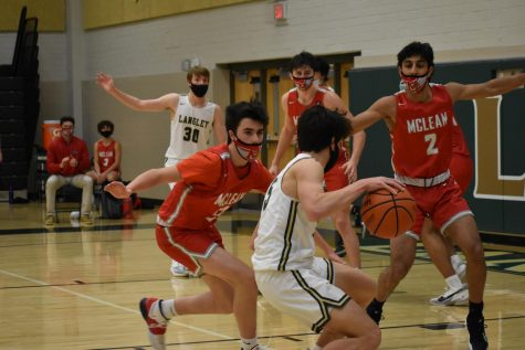 Sophomore Brendan Mansinne (#5) keeps the ball in Langley