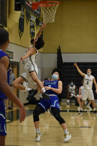Junior Amr Areikat goes for the layup during the 4th quarter. Even though the Saxons fought hard, South Lakes ended the game six points ahead.