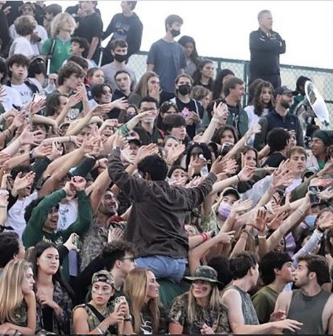 Students at Langley's 'Camo Out' game, against Madison James, cheer on their team from the student section. This was Langley's second home game of the year, and masks were not required.