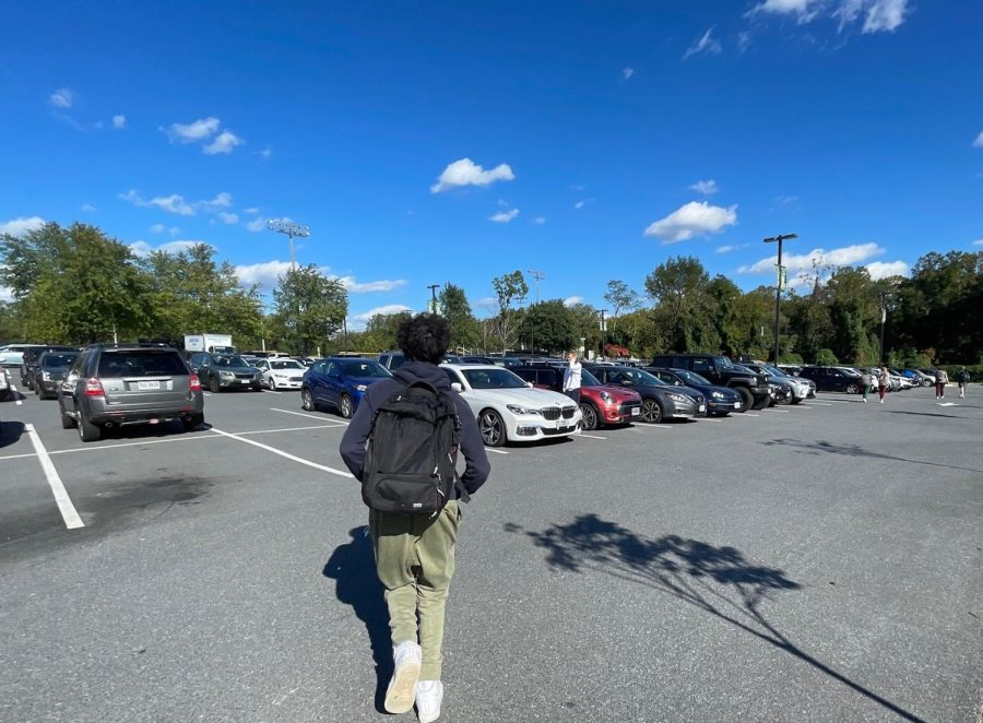 A Langley student rushes to his car to beat the traffic rush. The student ran to his nearby car in the parking lot.